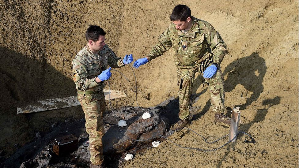 Military EOD experts examine an unexploded World War II bomb in Bethnal Green, London (Credit: Ministry of Defence)