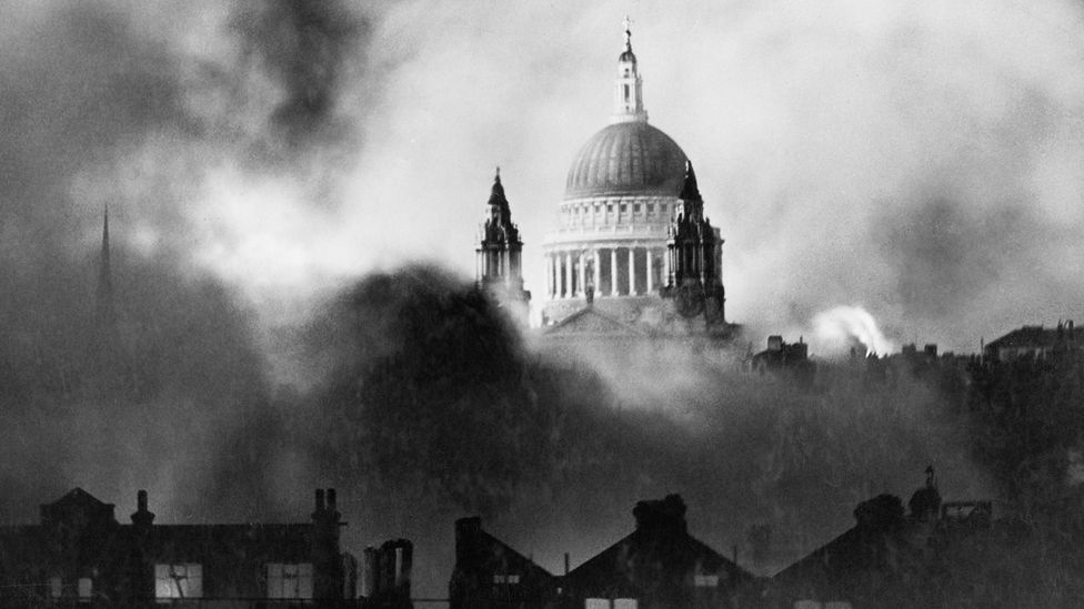 St Paul's Cathedral stands out from flames and smoke during the great fire raid in London (Credit: Imperial War Museum)