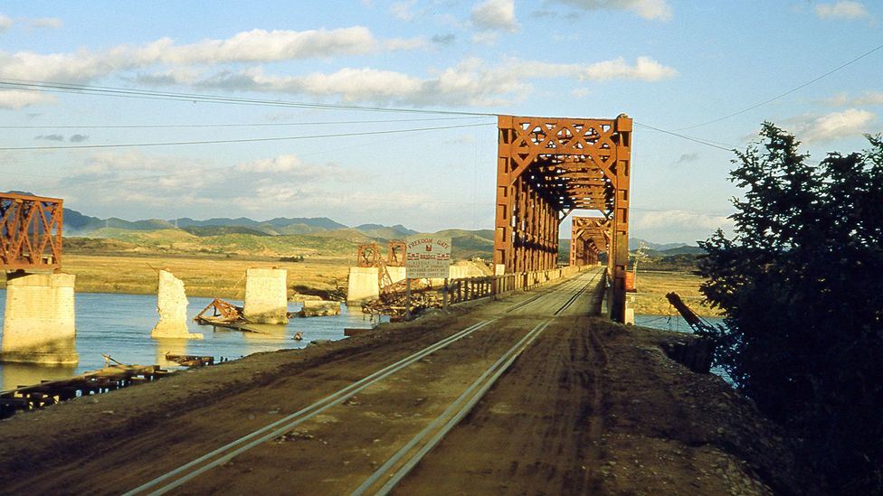 Freedom Gate railroad bridge links South Korea with the DMZ, which is perilous to cross but has become an unintended nature preserve (Credit: Smith Collection/Gado/Getty Images)