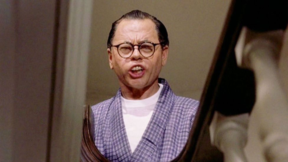 Mickey Rooney played a buffoonish Japanese businessman with fake buck teeth and coke bottle glasses in Breakfast at Tiffany's (Credit: Paramount Pictures)