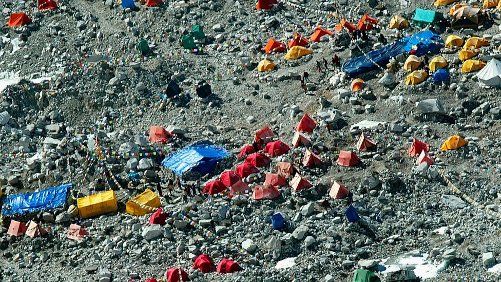 Bright tents mark the human presence in what was once a wilderness (Credit: Getty Images)