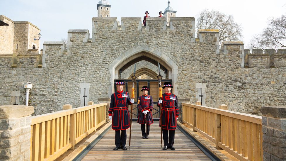 Yeoman Warders stand on the Tower of London's drawbridge, which was reinstated in 2014 (Credit: Richard Lea-Hair/Historic Royal Palaces)