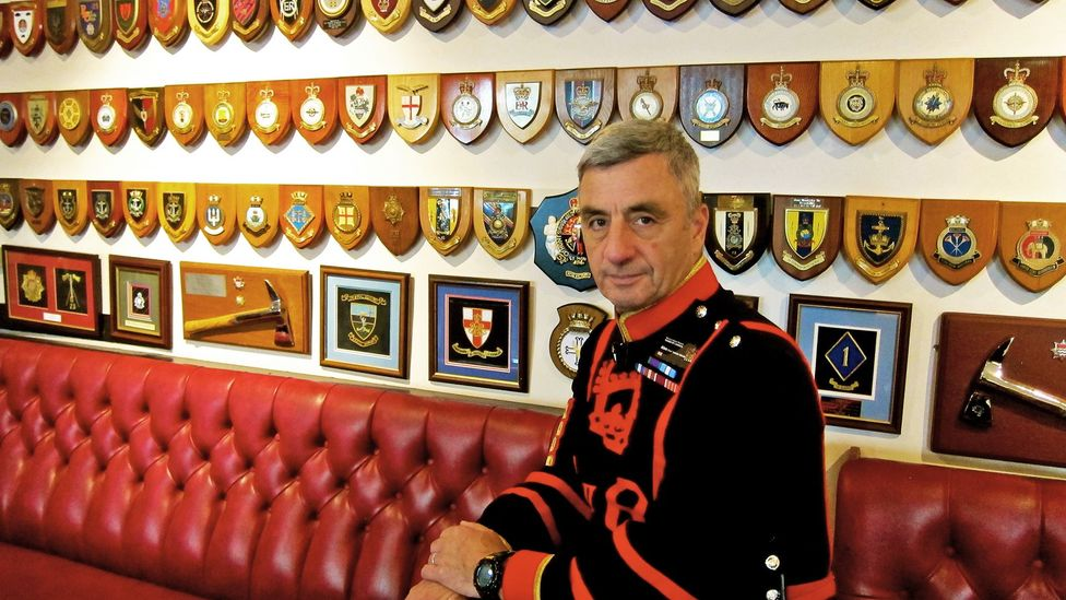 Chief Yeoman Warder Alan Kingshott sits inside the Yeoman Warders Club, the Tower of London's private pub (Credit: John Lee)