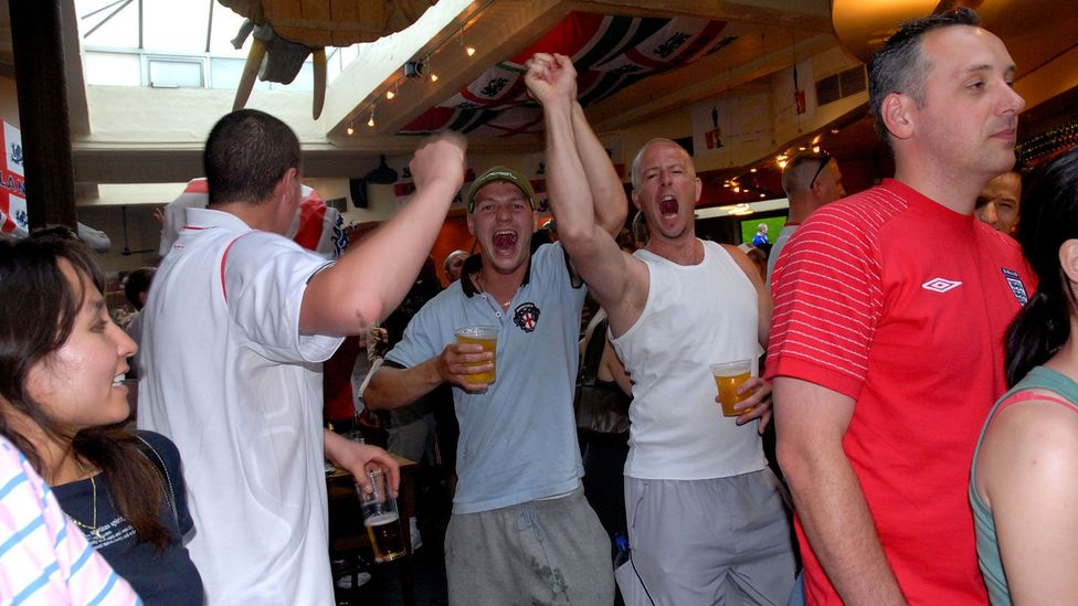 English football fans watch a World Cup match, lagers in hand; the drink is closely associated with British identity (Credit: Janine Wiedel Photolibrary/Alamy Stock Photo)