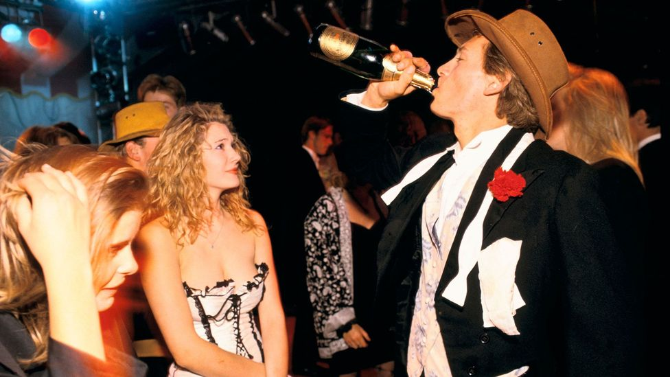 Young people party at a university ball; in the 2000s, drinking, and getting drunk, increasingly became the domain of 20-somethings (Credit: CountryCollection - Homer Sykes/Alamy)