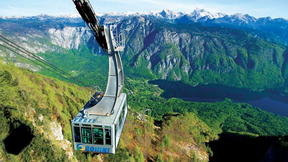 A cable car pulls up to the snow-covered top of Mount Vogel (Credit: Turizem Bohinj)