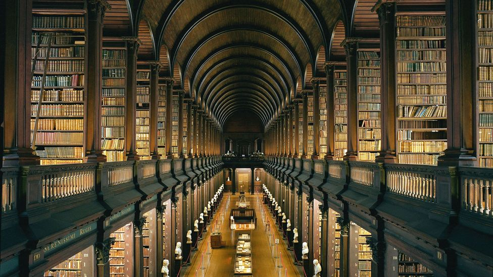 The Long Room of the Old Library of Trinity College, Dublin is timber-lined rising to a great barrel vault (Credit: incamerastock / Alamy Stock Photo)