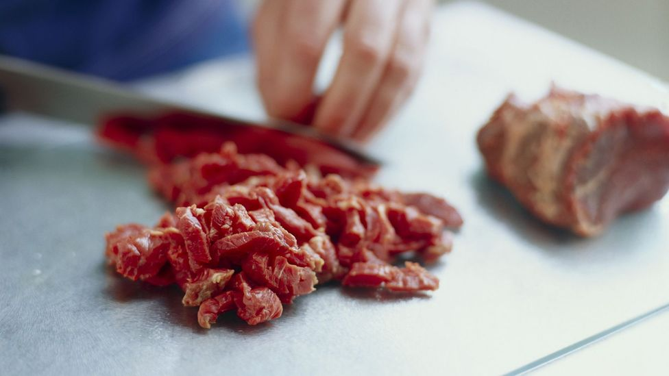 If you chop meat on a chopping board you should wash it right away (Credit: Science Photo Library)