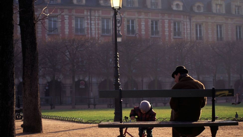 A father and son play in Place des Vosges (Credit: Jochem Wijnands/Horizons WWP/TRVL/Alamy)