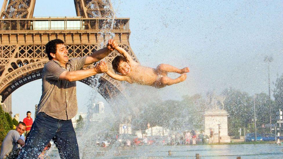 Playing in front of the Eiffel Tower (Credit: Look Die Bildagentur der Fotografen GmbH/Alamy)