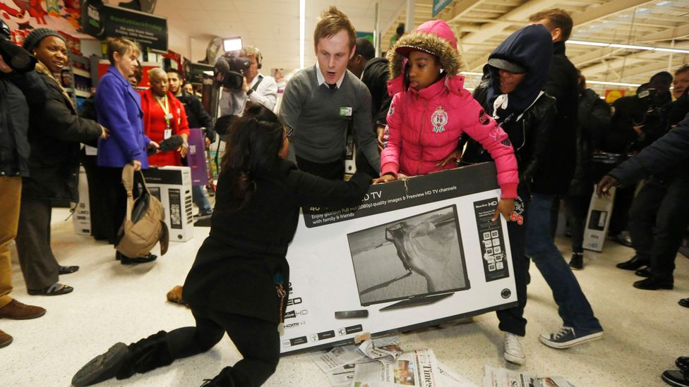 Black Friday frenzy in London: Shoppers in supermarket, Asda, fighting in the aisles over discounted televisions. (Credit: Corbis)
