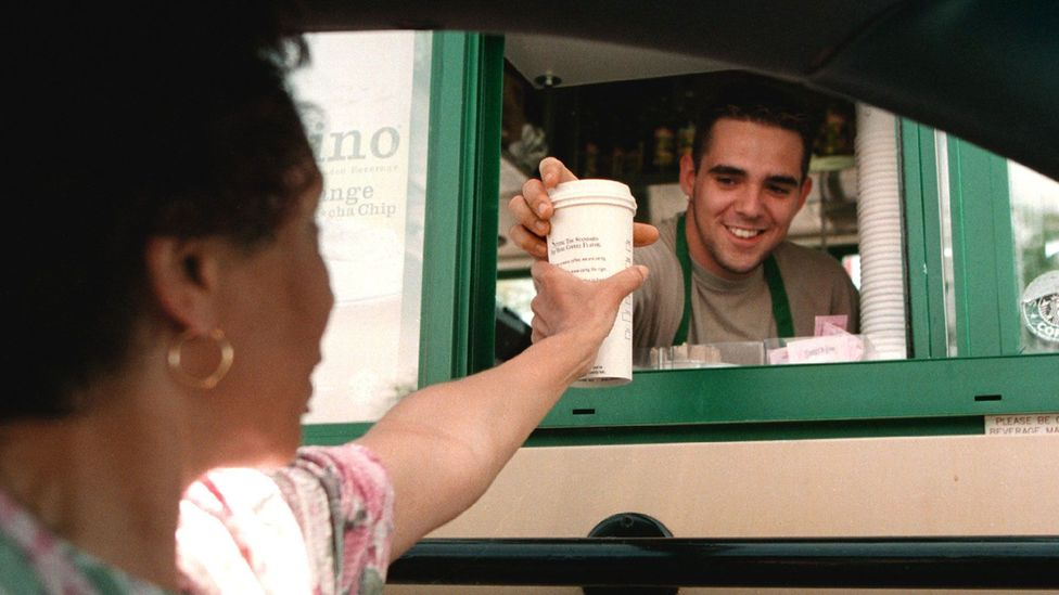 """As part of the """"paying it forward"""" movement, some coffee shops have seen chains of hundreds of customers buying each other's drinks (Credit: Getty Images)"""