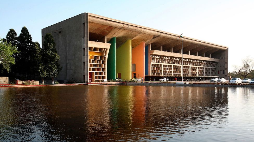 Chandigarh's High Court features a portico with brightly coloured pylons that contrast with the building's raw concrete (Credit: Dinodia Photos /Alamy Stock Photo)