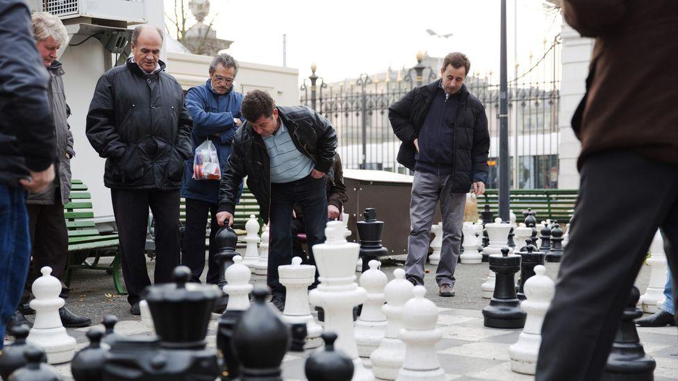 Men play chess in Geneva's Parc des Bastions (Credit: Martin Good/Thinkstock)
