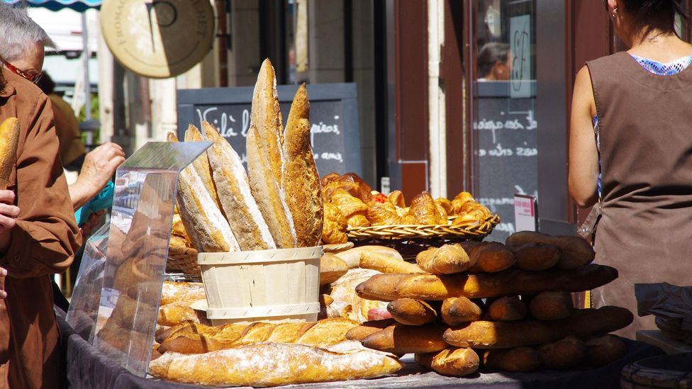 Shopping for bread is part of daily life in Dijon, France (Credit: Stephen Chapman/Alamy)