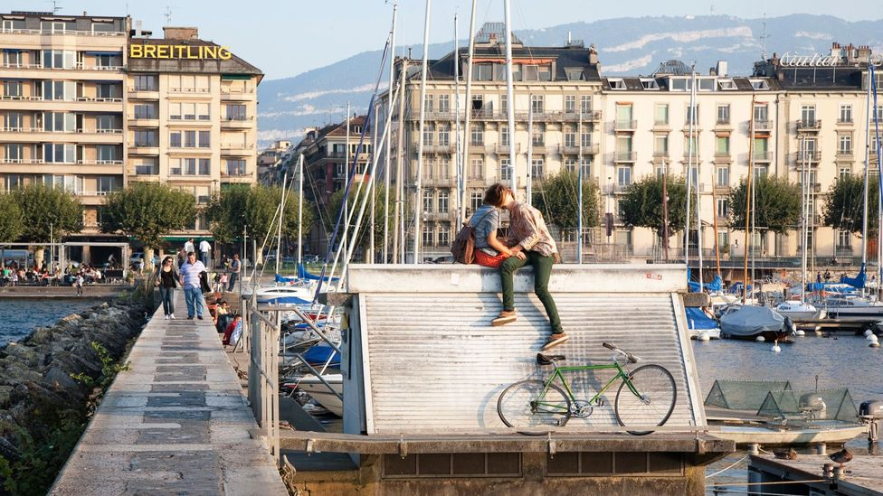Couple Kissing on the Pier in Geneva, Switzerland (Credit: Kevin George/Alamy)