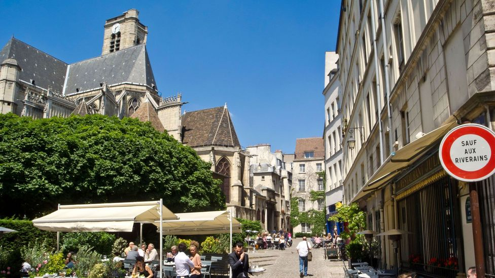 Napoleon III and Haussmann had their sights on areas like the Marais, a jumble of streets and houses that is now a major draw for tourists (Credit: Alamy)