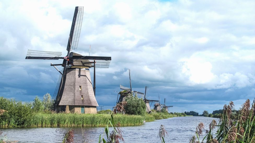 Volunteers show tourists how windmills operate at the World Heritage site of Kinderdijk (Credit: Ann Babe)