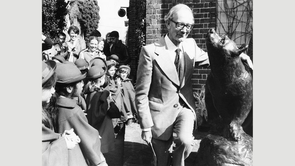 Christopher Robin Milne unveils a statue of a bear at London Zoo in 1981 (Credit: Keystone/Hulton Archive/Getty)