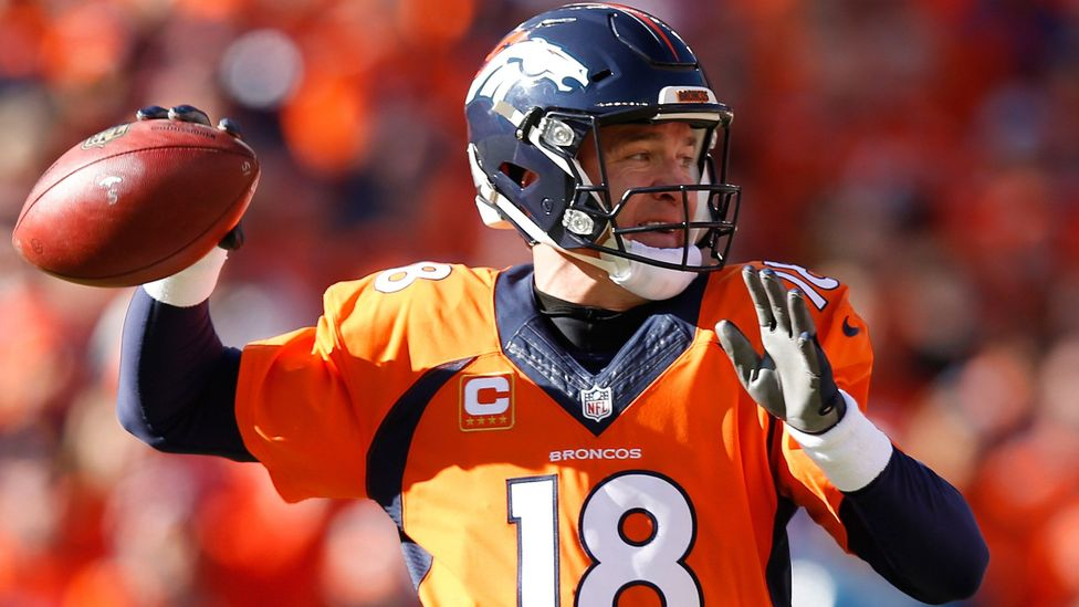 Denver Broncos, Peyton Manning, looks to pass against the New England Patriots. (Credit: Getty Images)