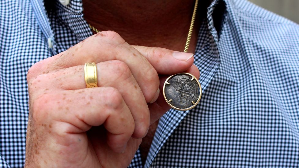 Steve St Amour wears a coin from another shipwreck around his neck (Credit: Chris Baraniuk)