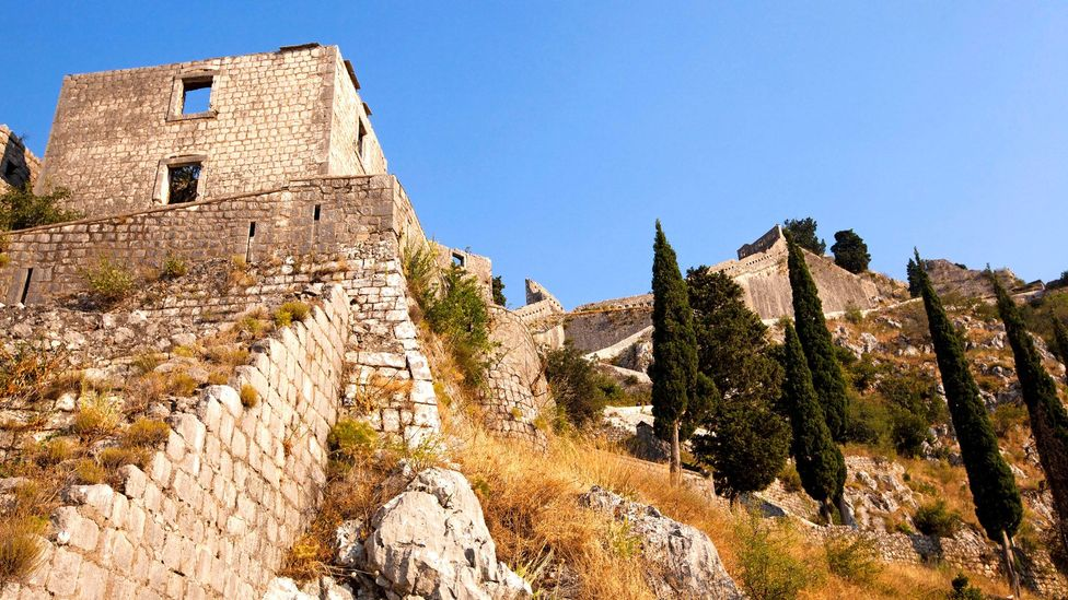 Kotor's ramparts seem to switchback up a steep mountainside (Credit: ihar leichonak/Alamy)