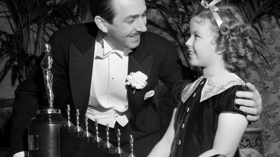 Shirley Temple presented Walt Disney with a special honorary award for Snow White and the Seven Dwarfs that took the form of seven miniature Oscars (Credit: Disney Enterprises)