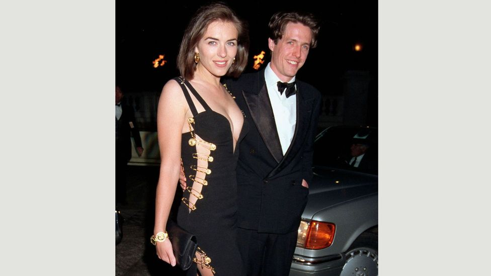 Elizabeth Hurley wore this Versace dress with gold safety pins to the premiere of Four Weddings and a Funeral in 1994 – and caused a sensation (Credit: Getty Images)