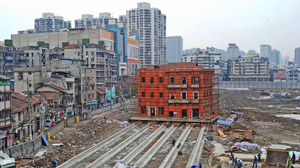 Workers prepare to move a building 90m in Wuhan, Hubei Province of China (Credit: ChinaFotoPress via Getty Images)