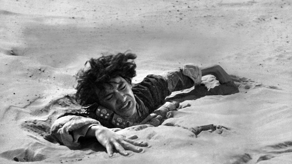 John Dimech in the 1962 film Lawrence of Arabia struggles in quicksand (Credit: AF Archive/Alamy)