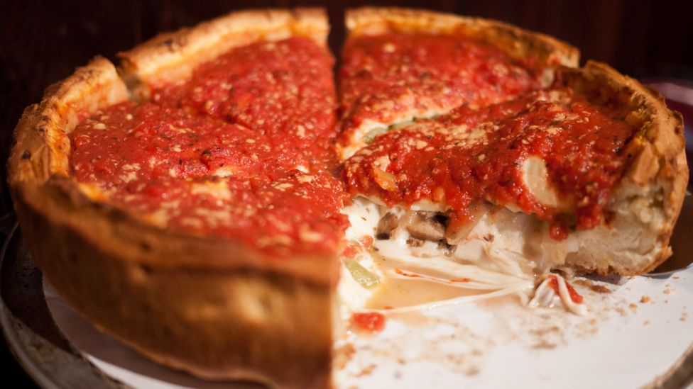 While no visit to Chicago is complete without tasting its famed deep dish pizza, the city's culinary scene has much more to offer gourmand business diners. (Credit: Alamy)