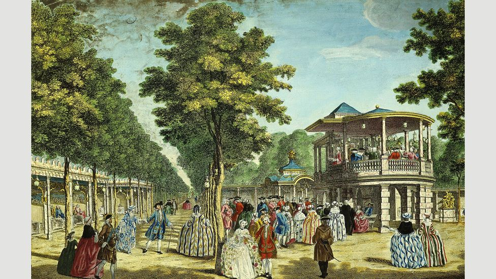 Company workers enjoyed numerous public holidays to relax, like people shown here in Vauxhall Gardens in 1751 (The Art Archive/Alamy)