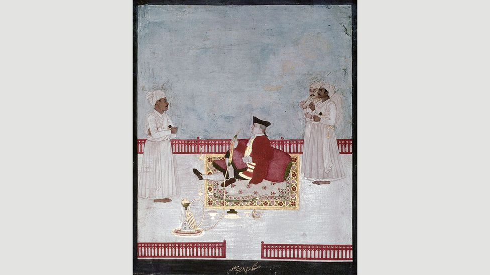 A Company official smokes a water-pipe in Mughal, India in 1760 (Credit: Heritage Image Partnership Ltd/Alamy)