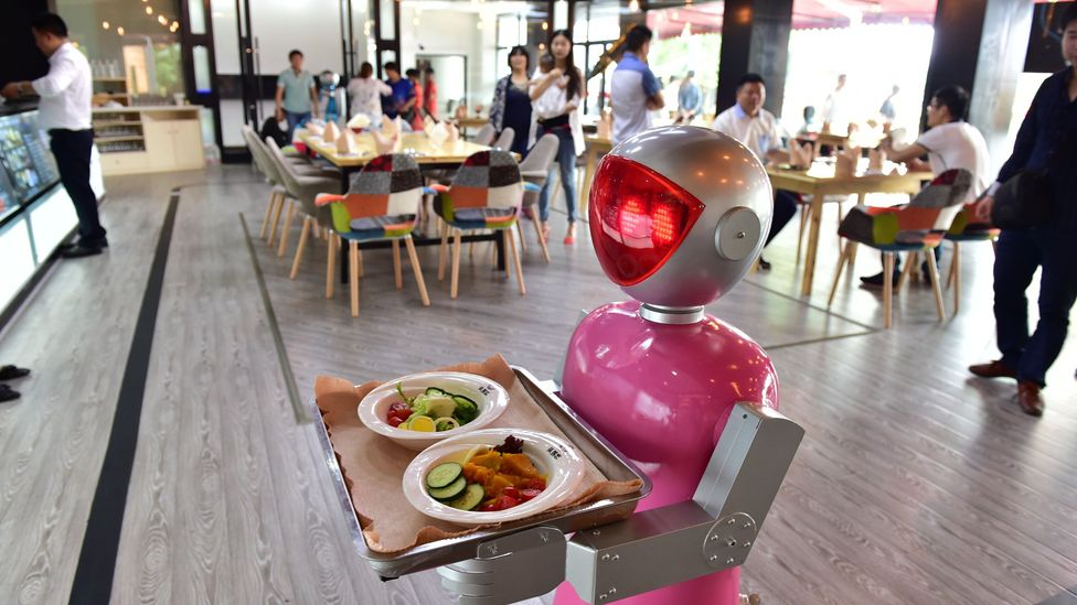 Moving up the ladder from waitressing soon robots may be handling your financial planning (Credit:ChinaFotoPress/ GettyImages)