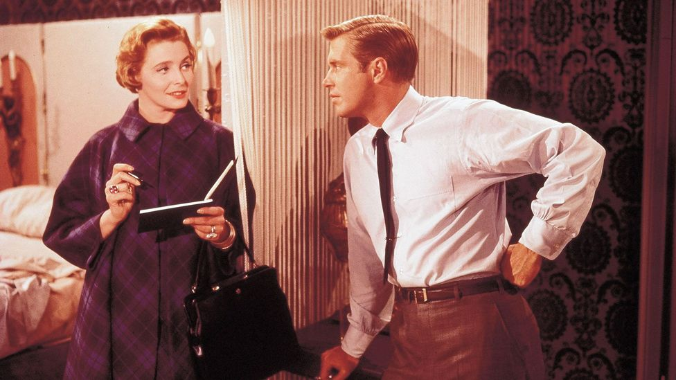 Paul (George Peppard) is also a kept man – his interior decorator (an older woman) leaves him cash after their romantic trysts (Credit:  Alamy)