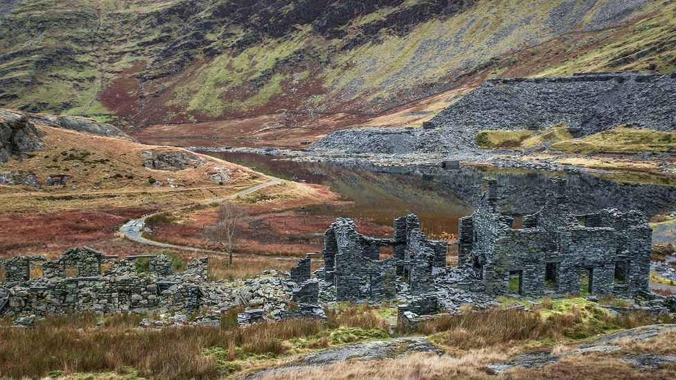 The walk to the mine passes abandoned workers' cottages (Credit: Digital-Fotofusion Gallery/Alamy)