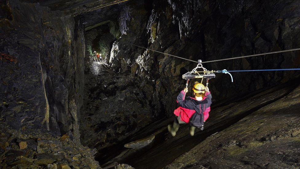 "The world's first underground ""zip ride"" uses what looks like a playground swing (Credit: Go Below Underground Adventures 2016)"