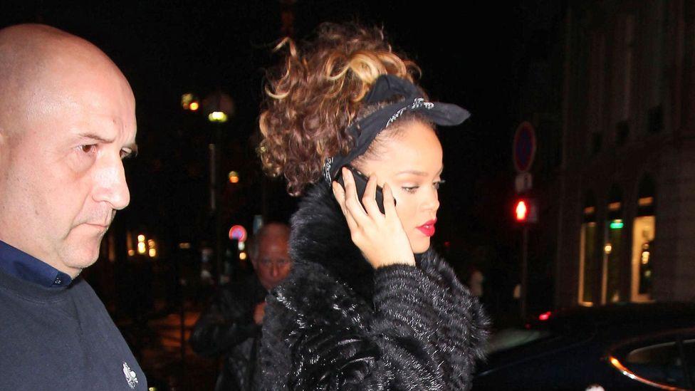Singer Rihanna still carries a flip-phone. (Credit: Alamy)