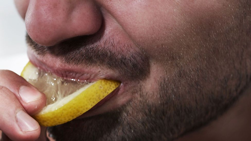 Introverts seem to react more strongly to intense sensations like the sour flavour of a lemon (Credit: Getty Images)