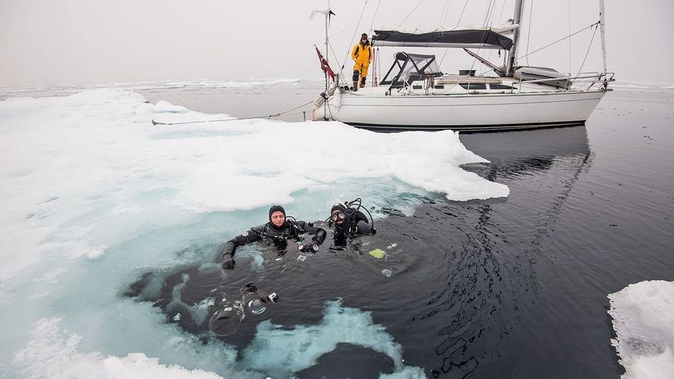 The captain and author prepared to dive under the ice. (Credit: Daniel Hug)