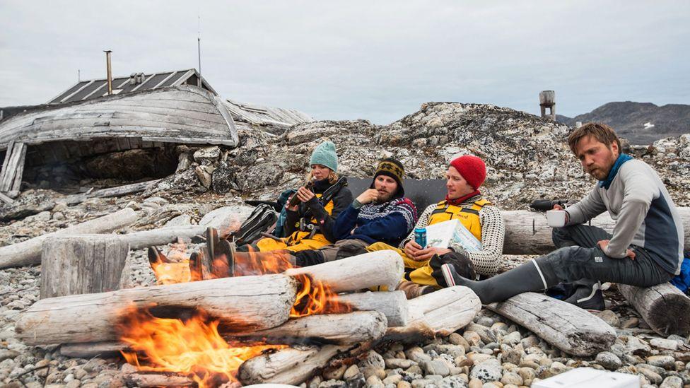 A driftwood bonfire on a lonely beach in northwest Svalbard. (Credit: Daniel Hug)