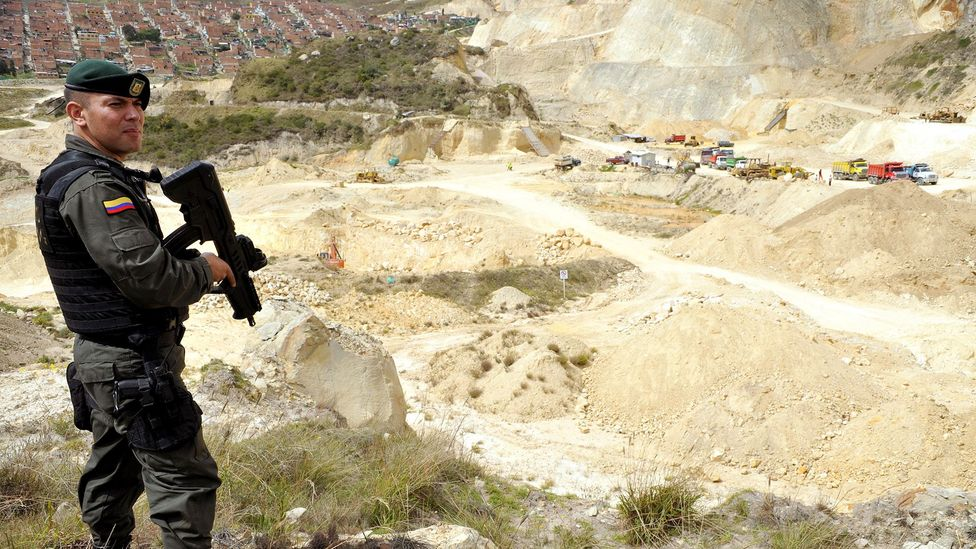 Demand for sand has led to the emergence of illegal mining of the material – here, a police officer stands guard in a quarry near Bogota, Colombia (Credit: Getty Images)