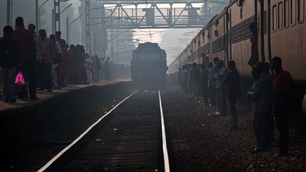 In India, passengers often use the trains track as a platform (Credit: Ed Hanley)