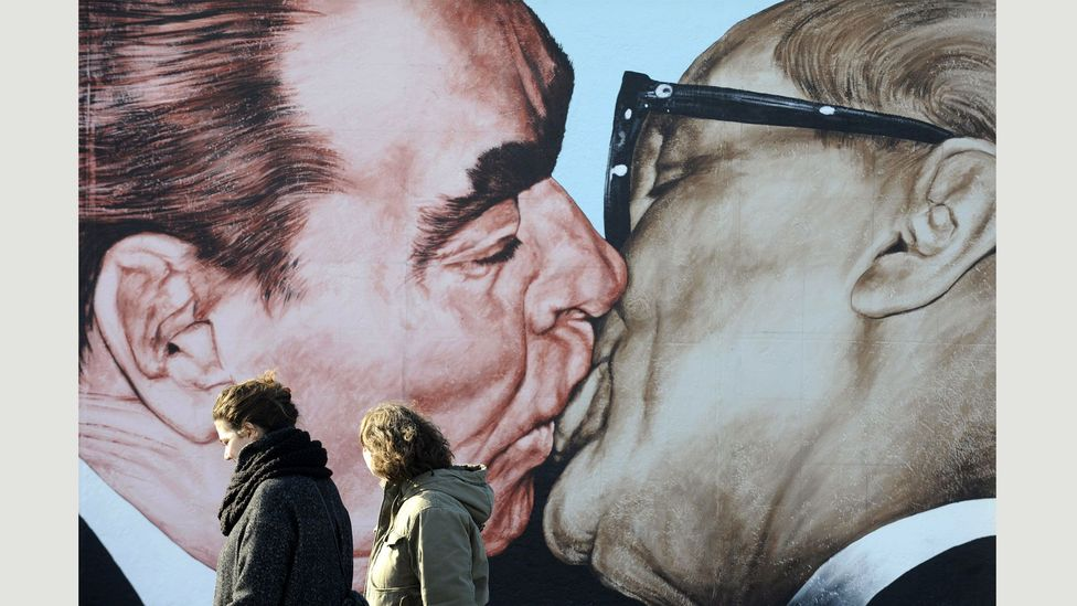 The new mural draws on this painting by Dmitry Vrubel, showing the Soviet leader Leonid Brezhnev and East German leader Erich Honecker (Credit: John Macdougall/AFP/Getty Images)