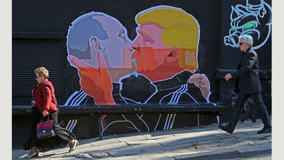 A new mural by the Lithuanian artist Mindaugas Bonanu shows Donald Trump and Vladimir Putin in a passionate embrace (Credit: Petras Malukas/AFP/Getty Images)