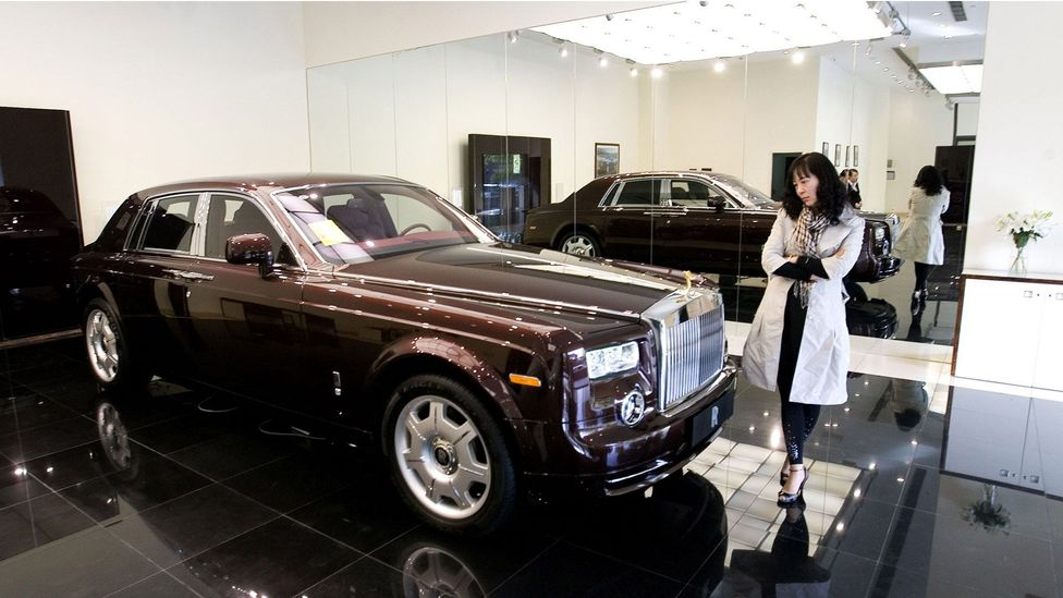 A shopper mulls a Rolls Royce Phantom for 8m yuan (Credit: Lucas Schifres/Getty Images)