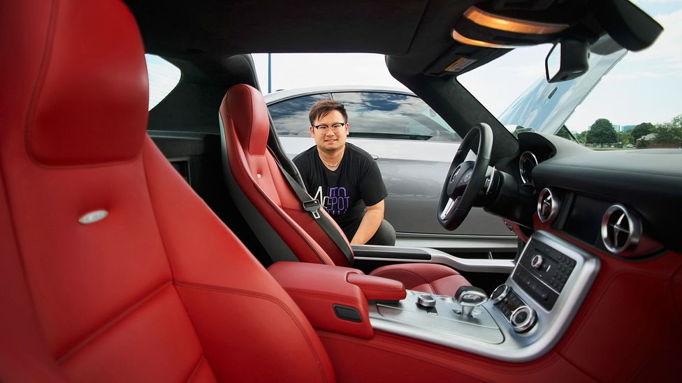 Nicholas Lam, cofounder of New York Auto Depot, and his 2012 Mercedes SLS. He has built a business selling cars to Chinese students in the eastern US. (Credit: Tom Starkweather)