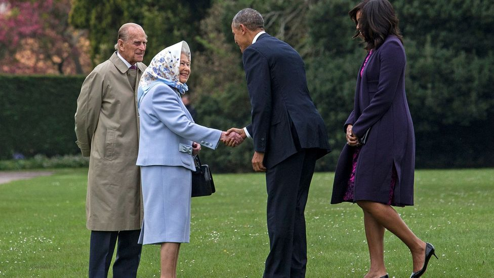 The Queen recently sported her signature headscarf to greet the Obamas – signalling an informal mood (Credit: Getty Images)