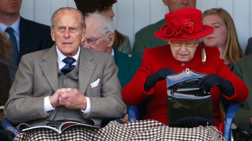The Queen's bags are created by British brand Launer, and she is said to own 200 of them (Credit: Getty Images)
