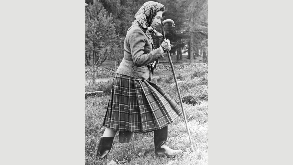 From the 1950s the Queen's Balmoral look has not changed – a tweed jacket or knitted twin-set, and a pleated Balmoral-tartan skirt (Credit: Getty Images)